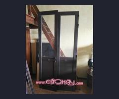 puerta 2 hojas aluminio con cristal