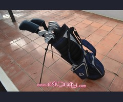 TaylorMade golf clubs, complete with bag