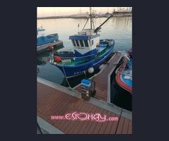 Barco de pesca lista tercera