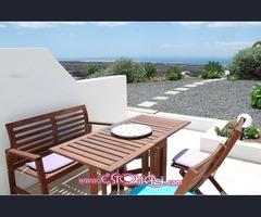 Apartamento con jardín y vistas al mar