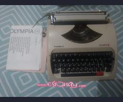 Maquina de escribir marca olympia